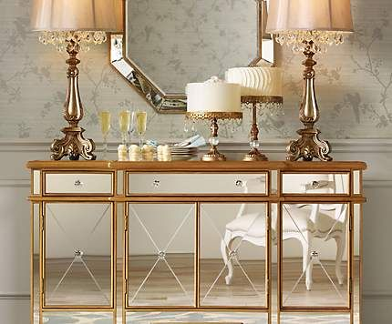 A mirrored console table becomes an eye-catching living room accent.