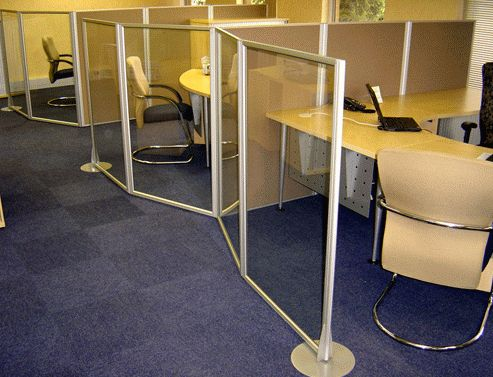 Floor based low level glass screens. Great for non invasive desk partitioning. #officespace #interiordesign