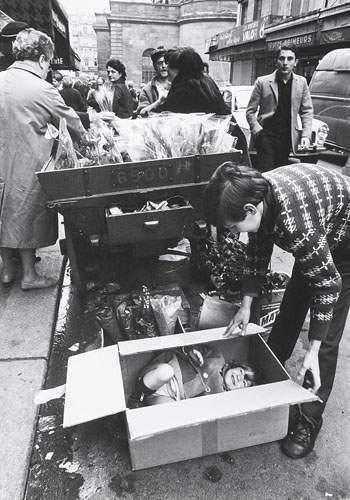 Vendeuse de muguet, Paris, ca. 1955 by Robert Doisneau
