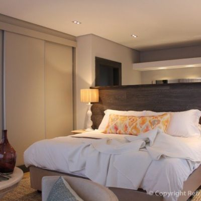 Bedroom 4 has a beautiful timber cladded wall, no need for a headboard here. Again, an oversized scatter with lovely raffia lamp shades. Refreshed Designs