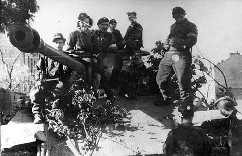 Polish fighters atop a German tank captured during the Warsaw Uprising
