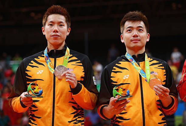 Silver medalists V Shem Goh and Wee Kiong Tan of Malaysia stand on the podium during the medal ceremony after the Men's Badminton Doubles competition on Day 14 of the Rio 2016 Olympic Games at Riocentro - Pavilion 4 on August 19, 2016 in Rio de Janeiro, Brazil.