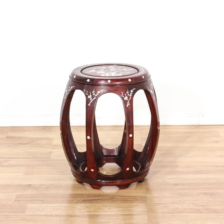 This stool is featured in a solid wood with a glossy rosewood finish. This Asian style garden stool has inlaid mother of pearl details, floral motifs, and rounded sides. Elegant piece that's also perfect as a small side table! #asian #chairs #stool #sandiegovintage #vintagefurniture