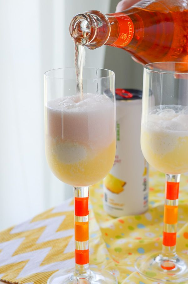 Orange Pina Colada Spritzer - don't give in to fall just yet! | Get the recipe on MyCookingSpot.com!