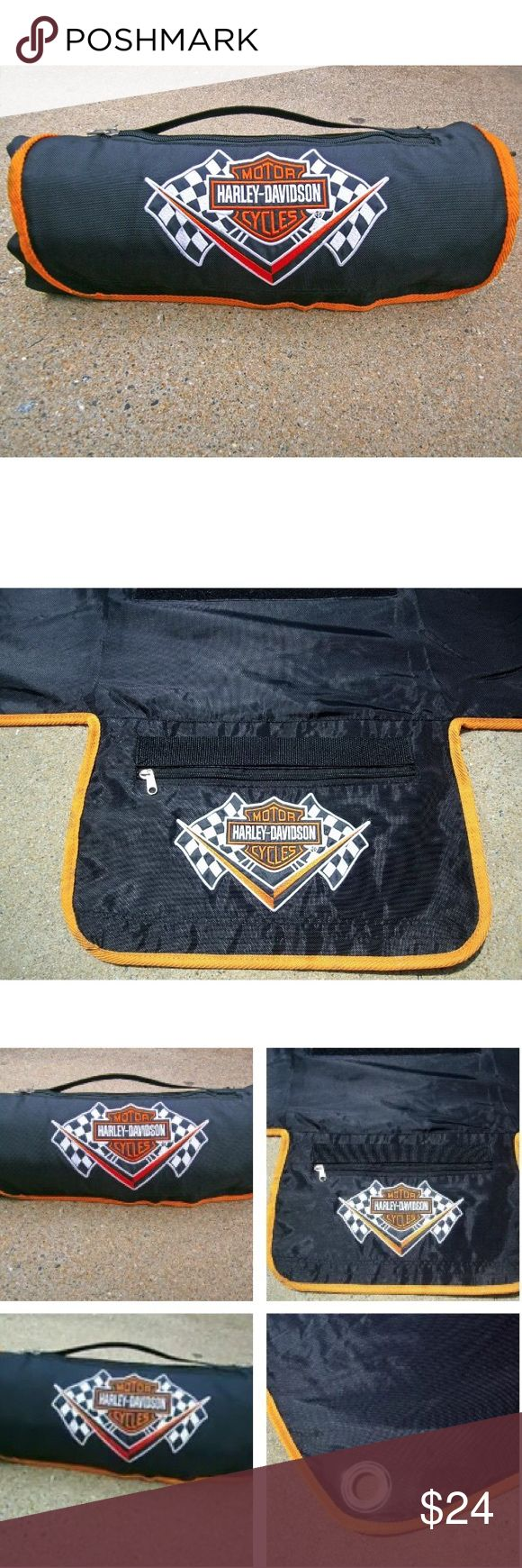"HARLEY DAVIDSON Picnic Blanket Bike Tarp Cover HARLEY DAVIDSON Roll Up Picnic Blanket Motorcycle Tarp Cover with Zipper Pocket  Authentic Harley Davidson Motorcycle Day Cover, Work Tarp or Picnic Blanket.  Soft fleece on one side and nylon on the other. Fold out bag with a zipper on top.  Black with orange trim & Harley Davidson logo.  Has grommets for tie-downs.   Dimensions: 54"" X 56""   Condition: Pre­-owned, EXCELLENT gently used condition. Free of stains, scuffs and damages. Very clean…"