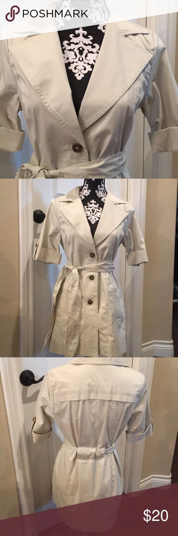 Cabi 3/4 length lightweight trench 🧥 Cabi brand  3/4 length lightweights trench coat  Soft cream color  So many ways to pair this.  Jeans, skirts ,Dress pants.  Leggings 3/4 length sleeves  Excellent condition  No dirt stains on markings Size 2 CAbi Jackets & Coats Trench Coats