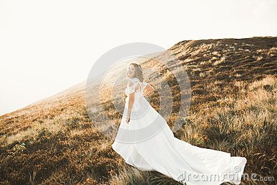 Beautiful Bride With A Bouquet On Mountain Background At Sunset - Download From Over 60 Million High Quality Stock Photos, Images, Vectors. Sign up for FREE today. Image: 92187972