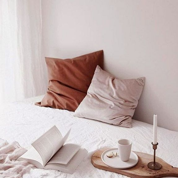 pink and red throw pillows in white bedroom. / sfgirlbybay