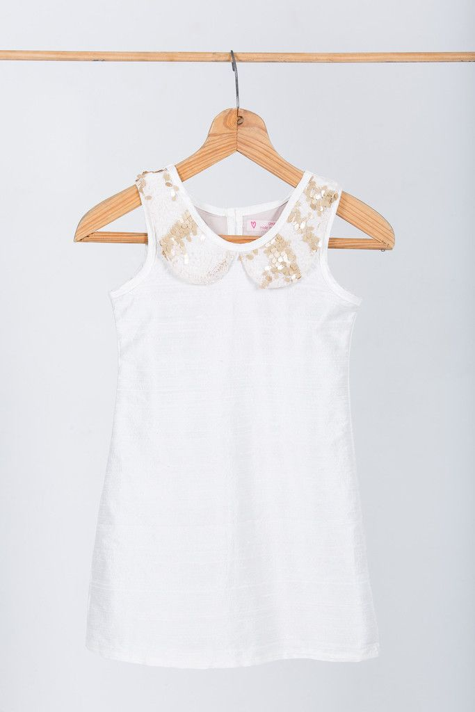 "Flower girl dress: ""Chanel"" made by GHAM. Price: R899. A crisp white 100 % raw silk slip dress. Lined with 100% cotton. Matt gold sequin lace collar. Cape Town, South Africa"