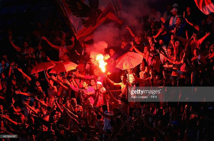 Supporters of Al Ahly SC let off flares during the FIFA Club World Cup 5th place match between Al Ahly SC and CF Monterrey at the Marrakech Stadium on December 18, 2013 in Marrakech, Morocco.