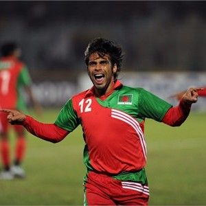 Bangladeshi footballer Md. Enamul Haque (C) celebrates after scoring