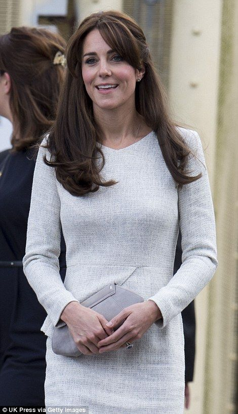 Still sporting her new bangs, the 33-year-old mother-of-two looked smart in an ivory and grey specked long sleeved dress