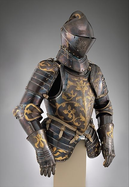 Half suit (1591) Anton Peffenhauser (1525–1603), German, Augsburg. Decorator: Attributed to Jörg Sorg the Younger (German, Augsburg, ca. 1522–1603) Medium: Steel, etched, blued, and gilt; leather; gilt bronze Dimensions: Wt., 46 lb. 3 oz. (20.96 kg); H., 38 11/16 in. (98.2 cm); helmet Wt., 11 lb. 9 oz. (5245 g). Foot-Combat Armor of Prince-Elector Christian I of Saxony (reigned 1586–91)  Metropolitan Museum of Art [27.206]