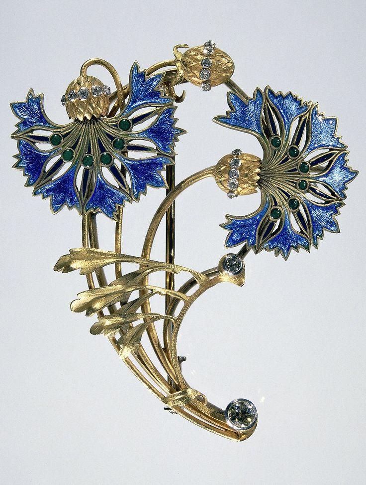 An Art Nouveau gold, diamond and enamel brooch, designed as cornflowers. Circa 1900-1910, maker unknown.