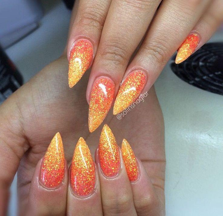 Sunset inspired glitter stiletto nails