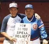 Popeye and the Bleacher Preacher. The sign was made and the picture was taken by photographer and legendary Cubs fan Jerry Pritikin aka Bleacher Preacher. The Bleacher Preacher DVD: https://www.createspace.com/403885