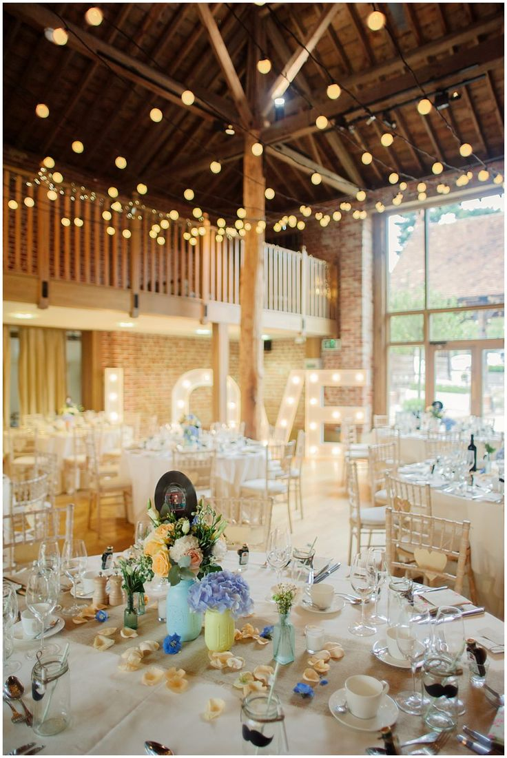 Giant marquee LOVE letters & festoon lights - Image by Kerrie Mitchell - Pastel Wedding With Shabby Chic Styling At Gaynes Park With Bride In Lace Fishtail Sarah Janks Gown With Groom In Powder Blue Bowtie From Mrs Bowtie And Images By Kerrie Mitchell