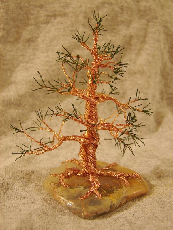 """Silver wire tree with crystal beads mounted on a chunk of crystal rock. Tree including base is 4"""" tall. This was a real challenge for me but I'm very happy with the way it turned out. I wish t..."""