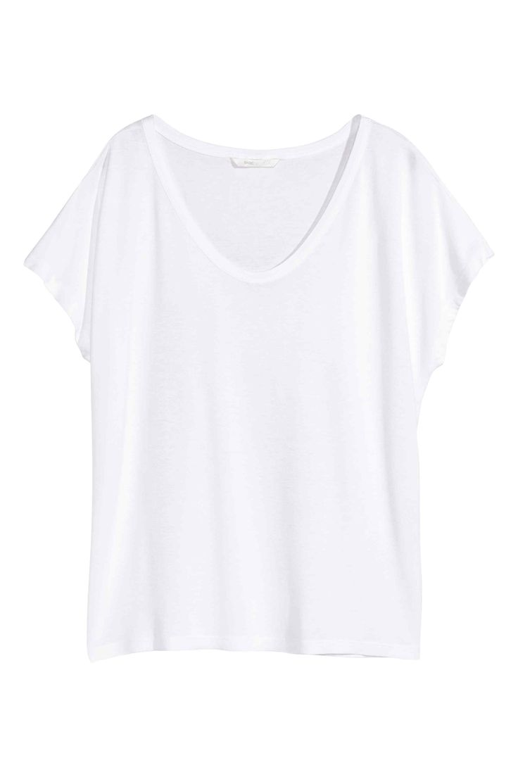 Wide jersey top: Wide, gently draping straight top in soft jersey with a slightly lower neckline at the front and short cap sleeves.