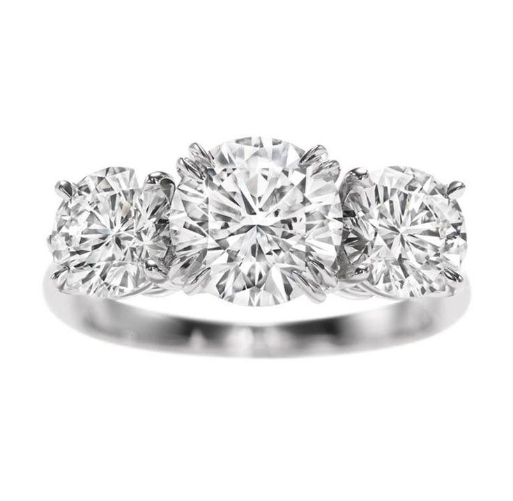 Harry Winston Round Brilliant Three Stone Diamond Ring. The dream.