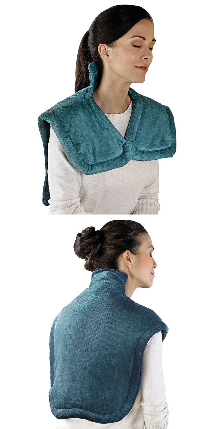 The Neck and Shoulder Heat Wrap - This is the heated wrap designed to simultaneously soothe sore muscles in the neck and shoulders. Unlike typical rectangular heating pads that do not provide ideal coverage or contact, this wrap—available exclusively from Hammacher Schlemmer—features slightly weighted edges and a magnetic closure that provide a custom fit around the neck, shoulders, and upper back. #GiftsforHer