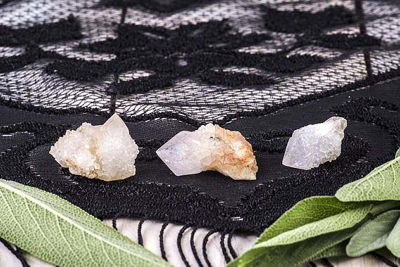 These three beautiful Spirit Quartz point clusters have incredible druzy sparkle. They are small, making them perfect for turning into jewelry. The center stone is Ametrine, meaning that both the amethyst and citrine colored crystals come together in the same stone.