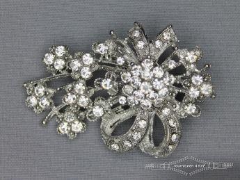 Strass broche 65mm strik zilver