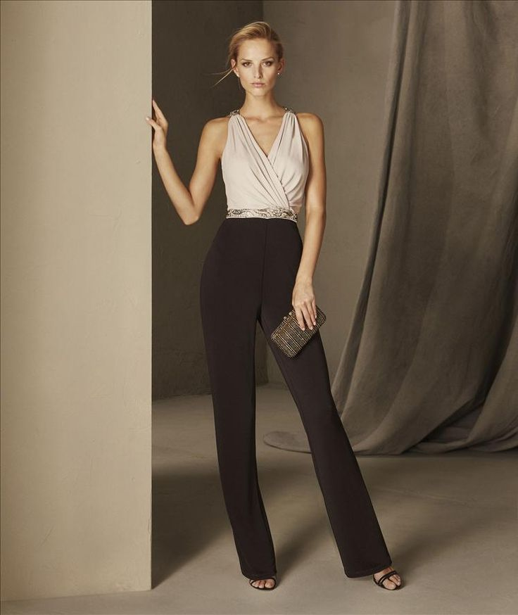 BRUNA - Spectacular two-tone cocktail jumpsuit with pants that are fitted at the waist and a loose top with a crew neckline.