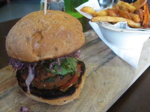 VegeRama Burger with a spiced black bean patty, wholemeal bun, Japanese slaw and beetroot slices served with rustic potato fries and aioli AU$17: