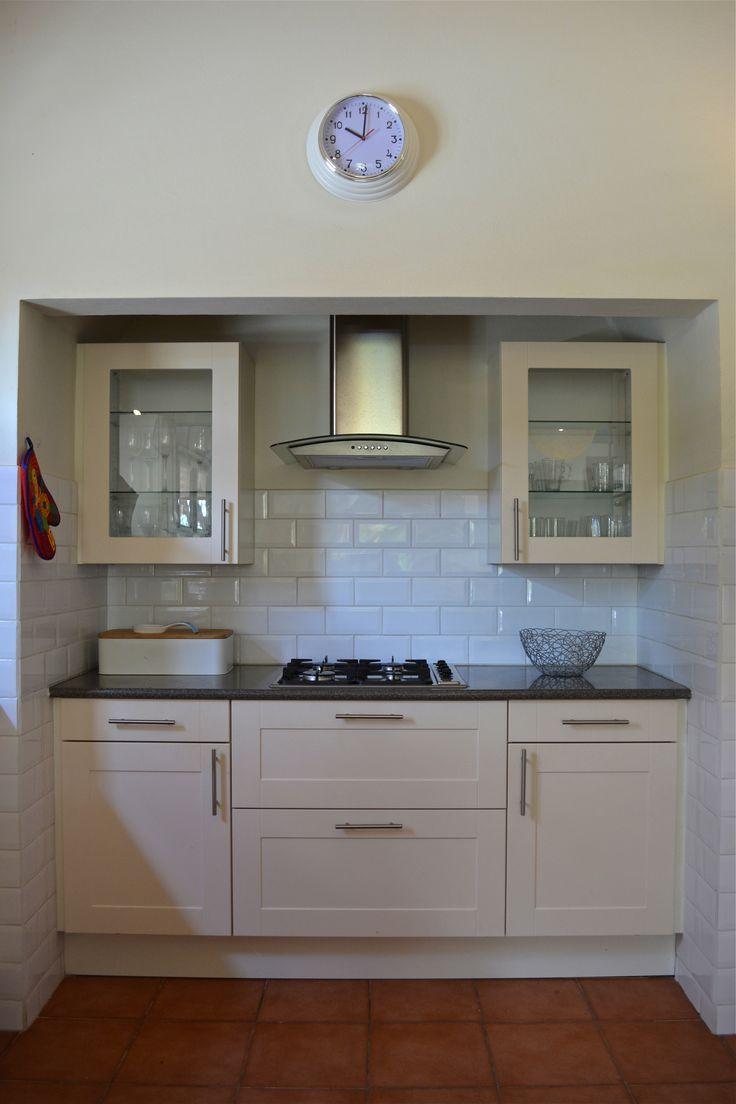 White minimalist kitchen with rectangular metro tiles.