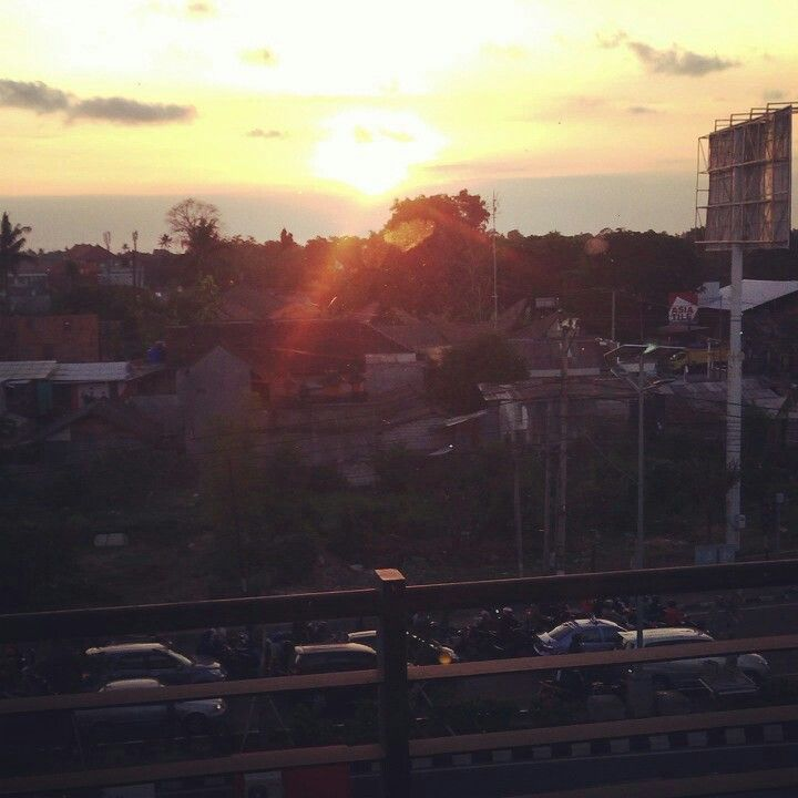 Sunset in jimbaran bali.photo taken from 3rd floor benoa square building