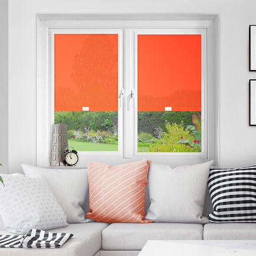 A rich bright orange custom made fabric perfect fit blind ideal for PVC windows.