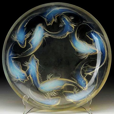 Born in Paris in 1860, Lalique was apprenticed to a Parisian jeweler, at the age of 16, while doing night school at the Ecole Des Beaux Arts. He went on to attend School of Art in Sydenham, England where he was inspired by the Arts and Crafts movement of the time. In 1885 Lalique purchased a small workshop in Paris and produced his own interpretation of the emerging Art Nouveau style jewelry and art glass especially vases which he became widely known and noticed for.
