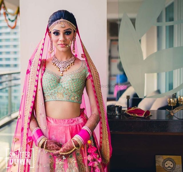 The mint and pink together is like a dream !!! Shot by @shutterdownphotography Makeup @simran.takkar . . Xoxo The wmg bride #indianbride #lehenga #pink #mint #colorblock #beautiful #bride #wedding #indianwedding #fuschia #pink #love