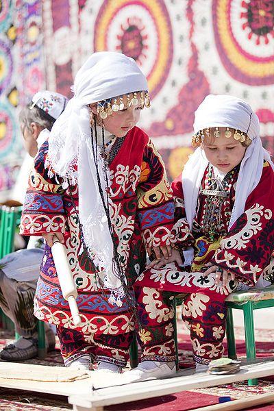 Darling little cutie pies in traditional costumes from Tajikistan.