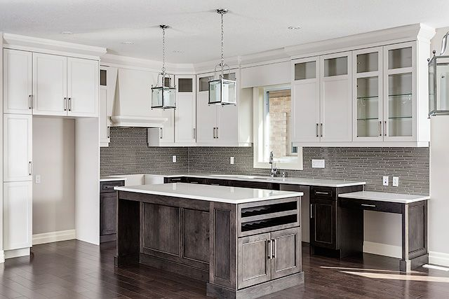 Beautiful Custom Kitchen by @gcwkitchens featured in our Willowbrook model ! #customhome #model #newhome #construction #design #storage #caesarstone #hardsurfacecountertops #lighting