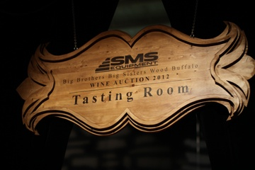 This custom sign was designed to match the event logo on all of the pre-event marketing materials and then customized for the event with vinyl decals and stain.