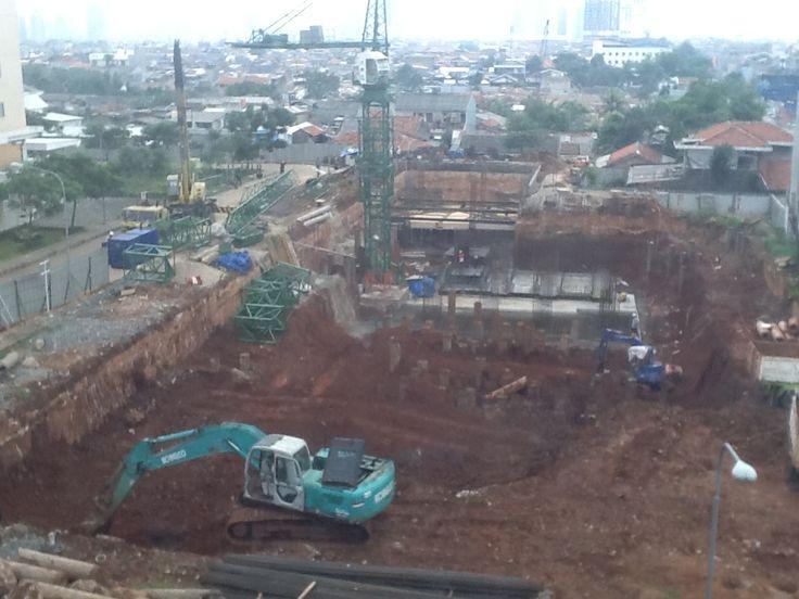 Excavation between piles.