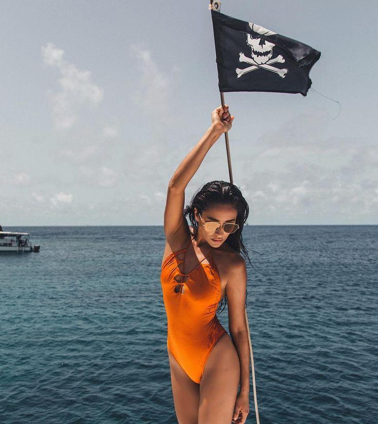"Shay Mitchell: ""Orange you glad it's almost fall #hadto"", orange one piece swimsuit"