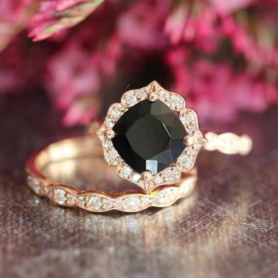 This vintage inspired bridal wedding ring set showcases a floral engagement ring with 8x8mm cushion cut natural black spinel set in a solid 14k rose