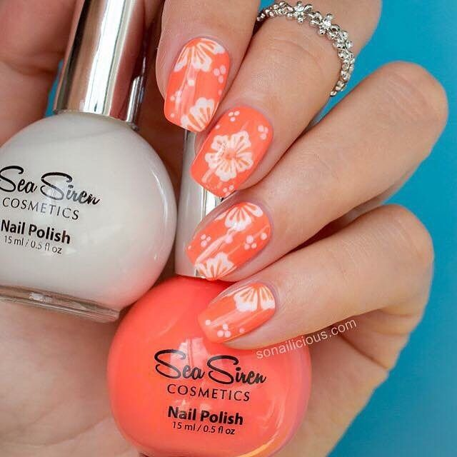 Hot, hot, hot today! Beautiful hibiscus  flowers created by the beautiful @so_nailicious using Clownfish Conga & Leucosia. Tropical.   Available in our Tsunami Australia Day Sale on now!  From A$5.50. Free shipping for orders over $60 Australia-wide. We ship internationally too. Get Onboard or Miss the Boat. 🐬 www.seasiren.com.au #seasirencosmetics #australiaday #nailpolish
