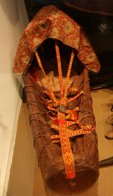Samisk komse. Sami craddle board with leather and woven bands. by saamiblog, via Flickr