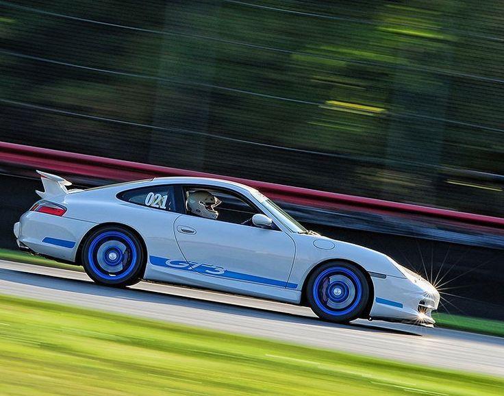 White and blue Porsche GT3 though the carousel at Mid Ohio.  #porsche #porsche911 #gt3 #racecarsofinstagram #racing #carsofinstagram #porschesofinstagram #midohiosportscarcourse
