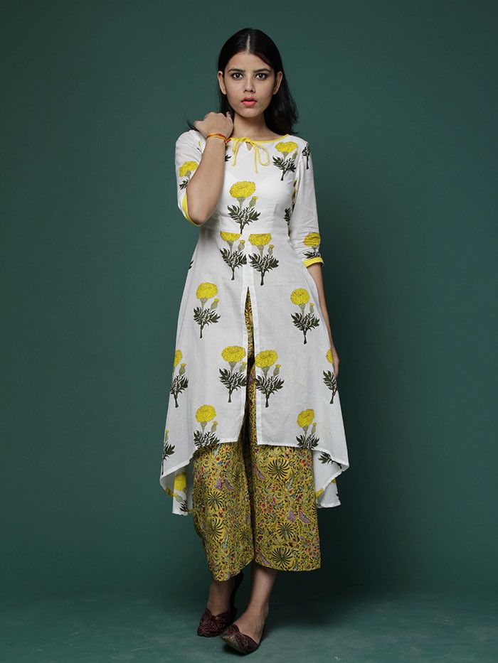 Description: A hand block printed high low cape with yellow mogra print and yellow printed wide leg pants. Cape has a front slit till waist line. Kurta Length: