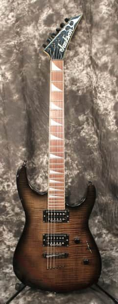The Jackson DK2T Dinky Electric Guitar is powered by a Seymour Duncan JB SH4 humbucker (bridge) and a Seymour Duncan Jazz SH2N humbucker (neck) mounted on a sleek alder body for plenty of warm, chunky tone. The rock maple neck sports a bound compound-radius maple fretboard. A scalloped heel means uninhibited access to the upper frets, while the JT390 adjustable bridge with string-through-body provides solid performance and tone. Used, excellent condition with a few minor scratches. All ...