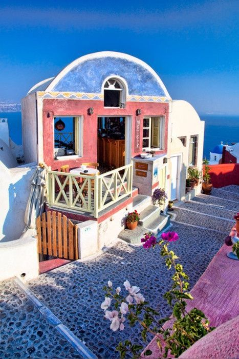 The path to the tiny Sidewalk Cafe - Santorini, Greece