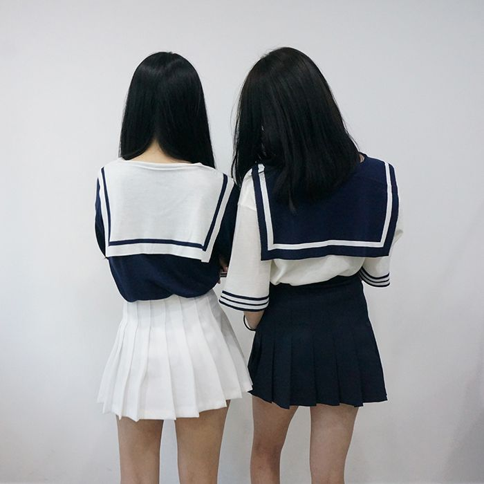 School girl Uniform - Meets conformity needs because they all wear the same thing so they all fit in.