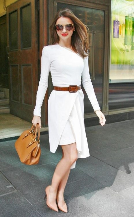 Miranda Keer in a white Willow dress, looking professional and fashion forward