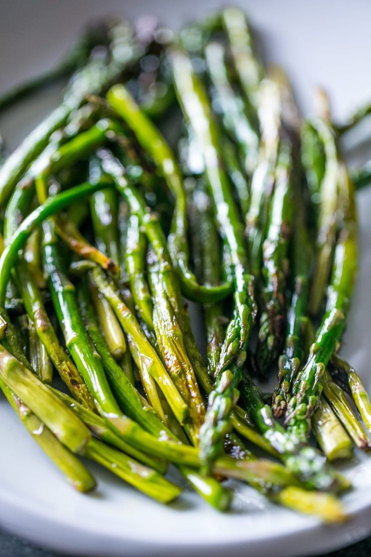 Quick, delicious, and so easy - this pan fried asparagus is simple and fresh! Perfect for paleo or whole 30 diets, under 110 calories per serving!