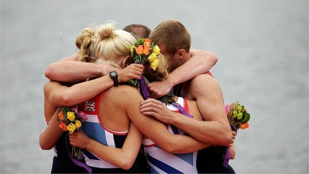 The Great Britain Mixed Coxed Four Rowing team hug each other in celebration during the VictoryCeremony after winning gold on Day 4 of the London 2012 Paralympic Games at Eton Dorney.